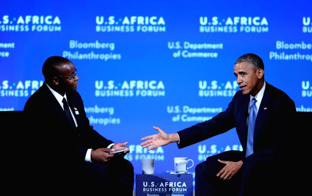 U.S. President Barack Obama (R) attends the business forum of the first U.S.-Africa Summit in Washington D.C., capital of the United States, Aug. 5, 2014. ...