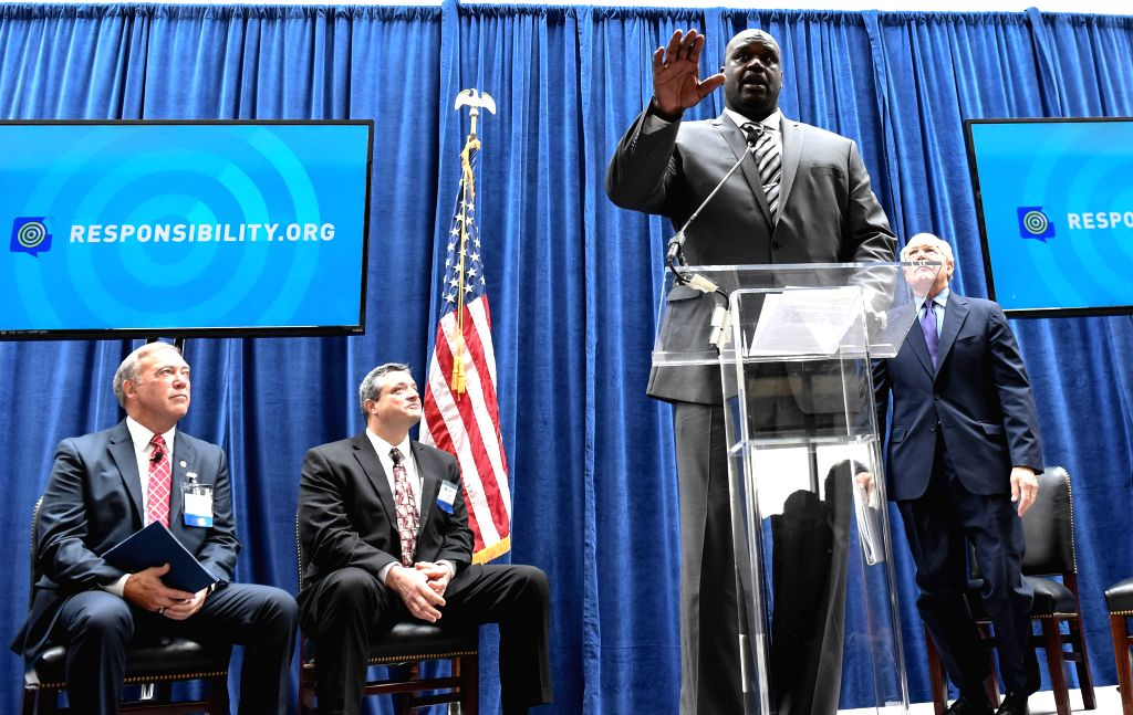 """WASHINGTON D.C., Dec. 1, 2016 - Former NBA star Shaquille O'Neal (front) speaks as he attends a panel discussion on """"Drug-Impaired Driving: The Challenges Facing Law Enforcement"""" as a ..."""