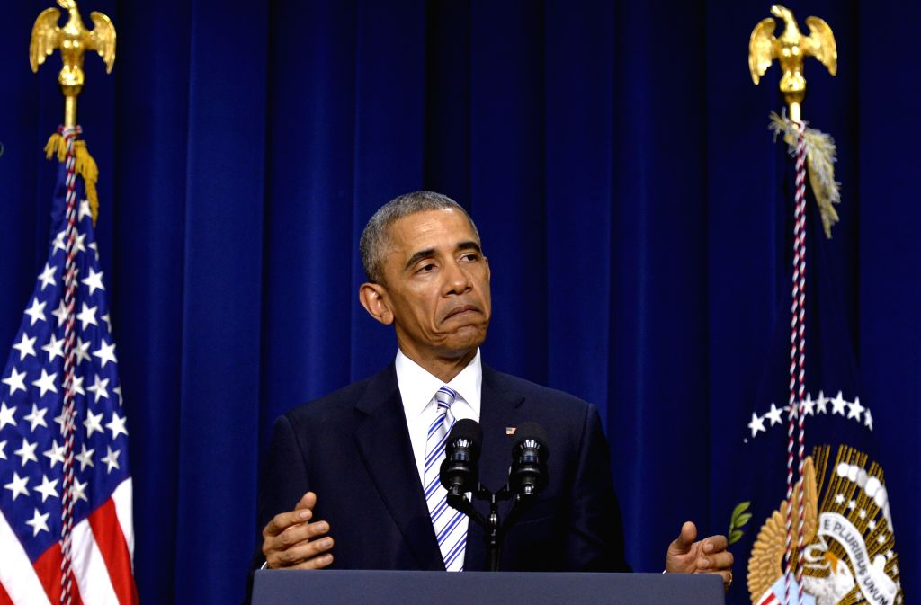 U.S. President Barack Obama speaks during keynote remarks of the White House Summit on countering violent extremism at the South Court Auditorium of the ...