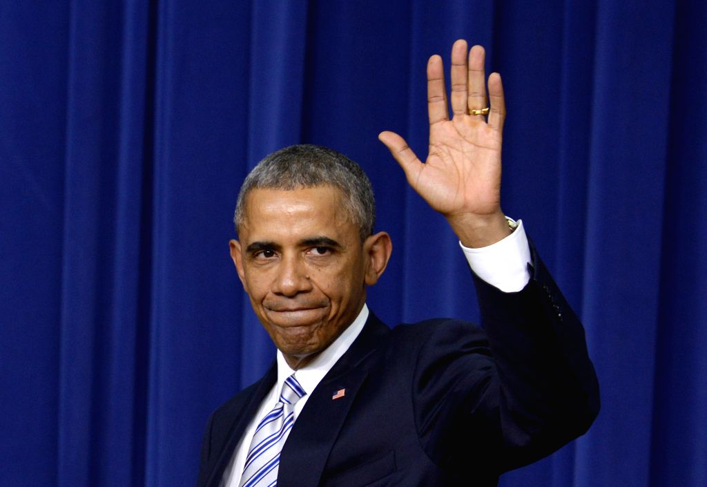 U.S. President Barack Obama leaves after keynote remarks of the White House Summit on countering violent extremism at the South Court Auditorium of the ...
