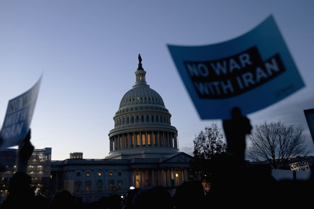 WASHINGTON D.C., Jan. 10, 2020 Signs are seen during a rally against war with Iran outside the Capitol Hill in Washington D.C., the United States, Jan. 9, 2020.