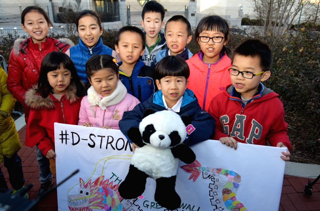 Children of Chinese diplomats send their best wishes to Dorian Murray, an American boy suffering from cancer, at Chinese Embassy in Washington D.C., capital ...