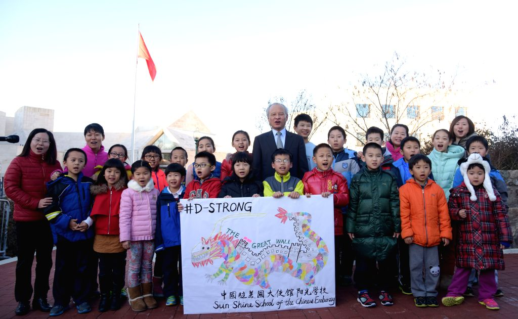 Chinese Ambassador to the United States Cui Tiankai (C) and children of Chinese diplomats send their best wishes to Dorian Murray, an American boy suffering ...