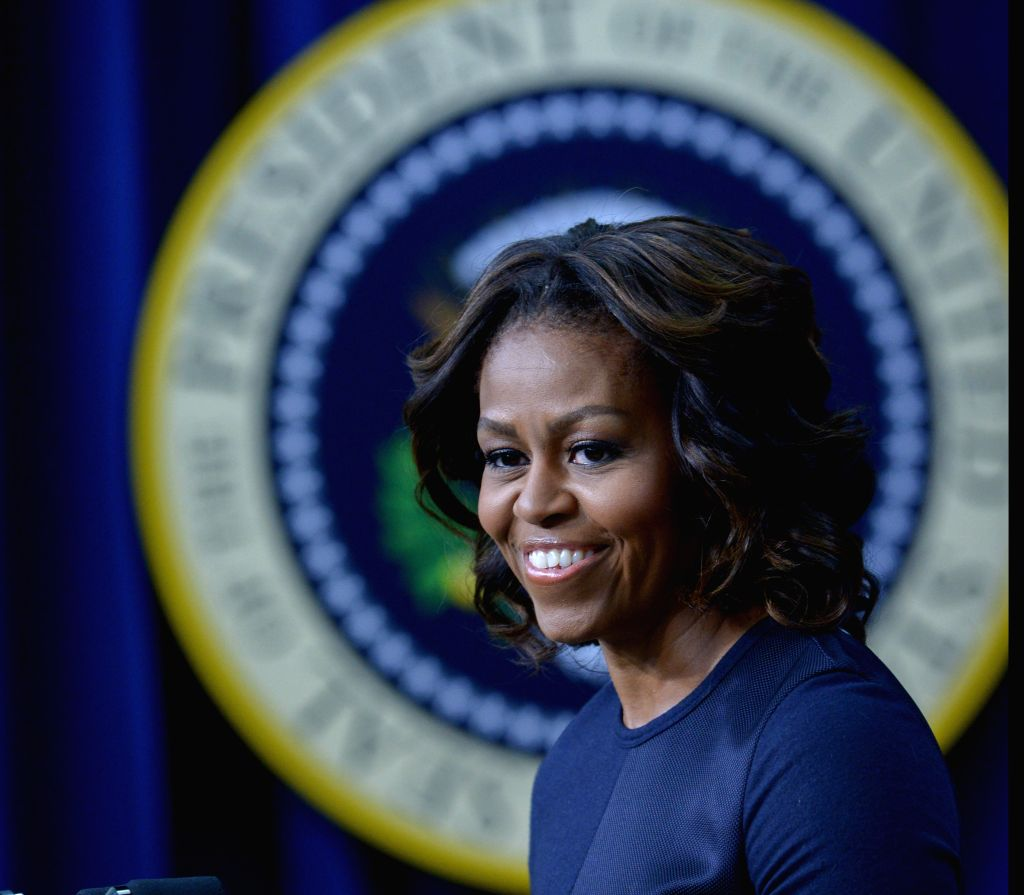 WASHINGTON D.C., Jan. 16, 2014 (Xinhua) -- U.S. First Lady Michelle Obama speaks during an event on expanding college opportunity in the South Court Auditorium of the Eisenhower Executive Office Building, next to the White House in Washington D.C., t