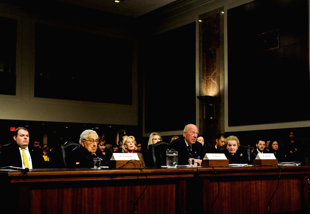 Former U.S. Secretary of State Henry Kissinger (2nd L), George P. Shultz (3rd L) and Madeleine Albright (4th L) testify before the Senate Armed Services ...