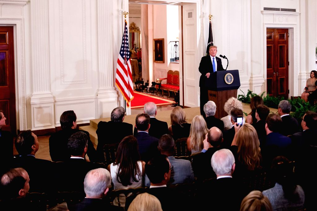 WASHINGTON D.C., July 10, 2018 - U.S. President Donald Trump (back) speaks during his announcement of the Supreme Court nominee at the White House in Washington, D.C., the United States, on July 9, ...