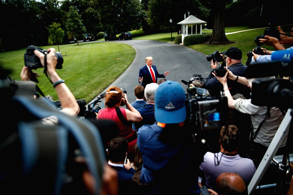 WASHINGTON D.C., July 25, 2019 - U.S. President Donald Trump speaks to reporters before leaving the White House in Washington D.C. July 24, 2019. Trump on Wednesday vetoed congressional resolutions ...