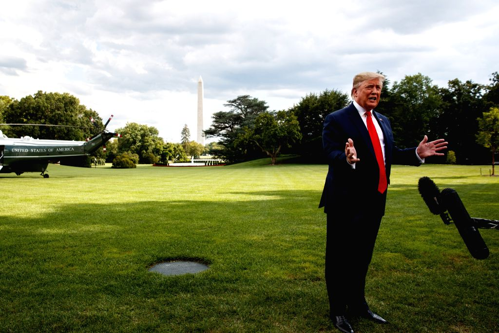 WASHINGTON D.C., July 25, 2019 (Xinhua) -- U.S. President Donald Trump speaks to reporters before leaving the White House in Washington D.C. July 24, 2019. Trump on Wednesday vetoed congressional resolutions that intend to block the Trump administrat