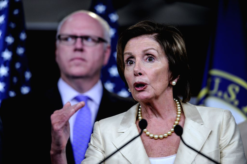 Nancy Pelosi(Front), Democratic leader of the United States House of Representatives, speaks on a news conference about resolution to sue the U.S. President