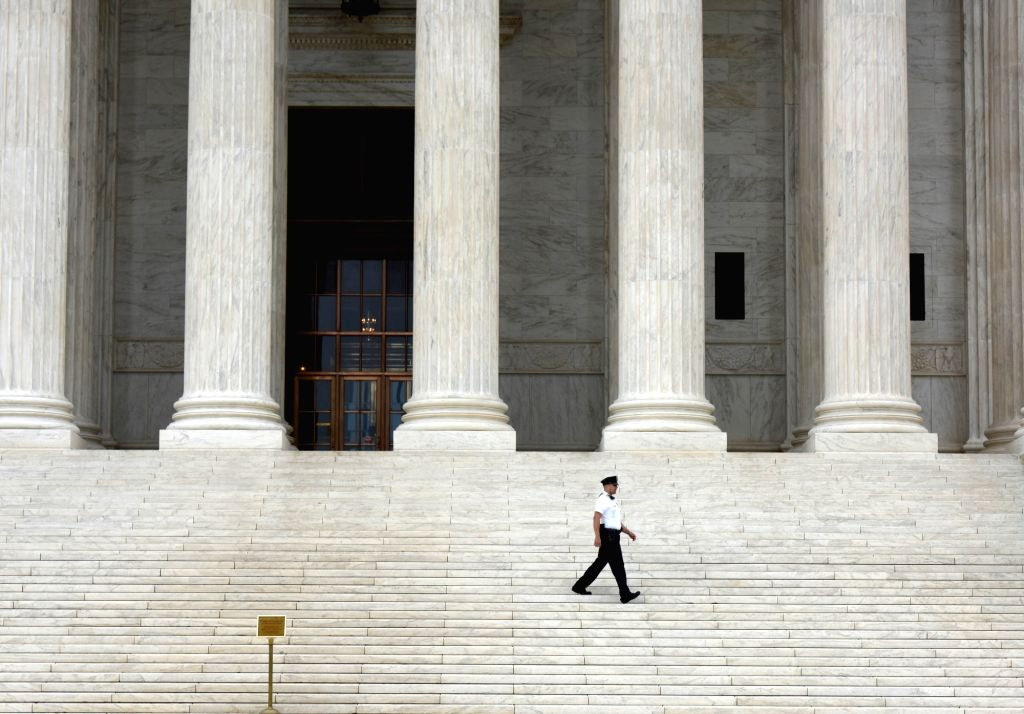 WASHINGTON D.C., June 23, 2016 - A policeman guards outside the Supreme Court in Washington D.C., the United States, on June 23, 2016. U.S. Supreme Court on Thursday delivered a heavy blow to the ...