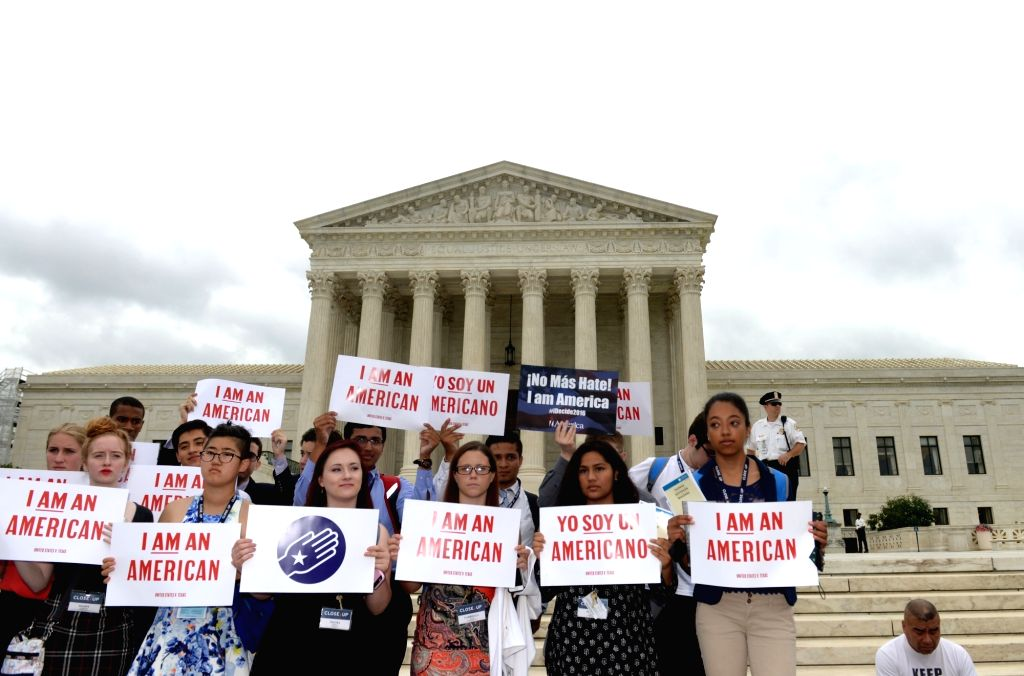 WASHINGTON D.C., June 23, 2016 - People attend an immigration rally outside the Supreme Court in Washington D.C., the United States, on June 23, 2016. U.S. Supreme Court on Thursday delivered a heavy ...