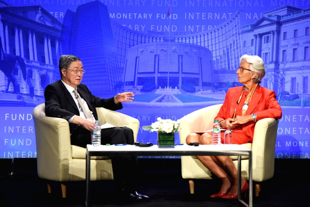 WASHINGTON D.C., June 24, 2016 - China's central bank governor Zhou Xiaochuan(L) talks with the International Monetary Fund(IMF) Managing Director Christine Lagarde after his lecture in Washington ...