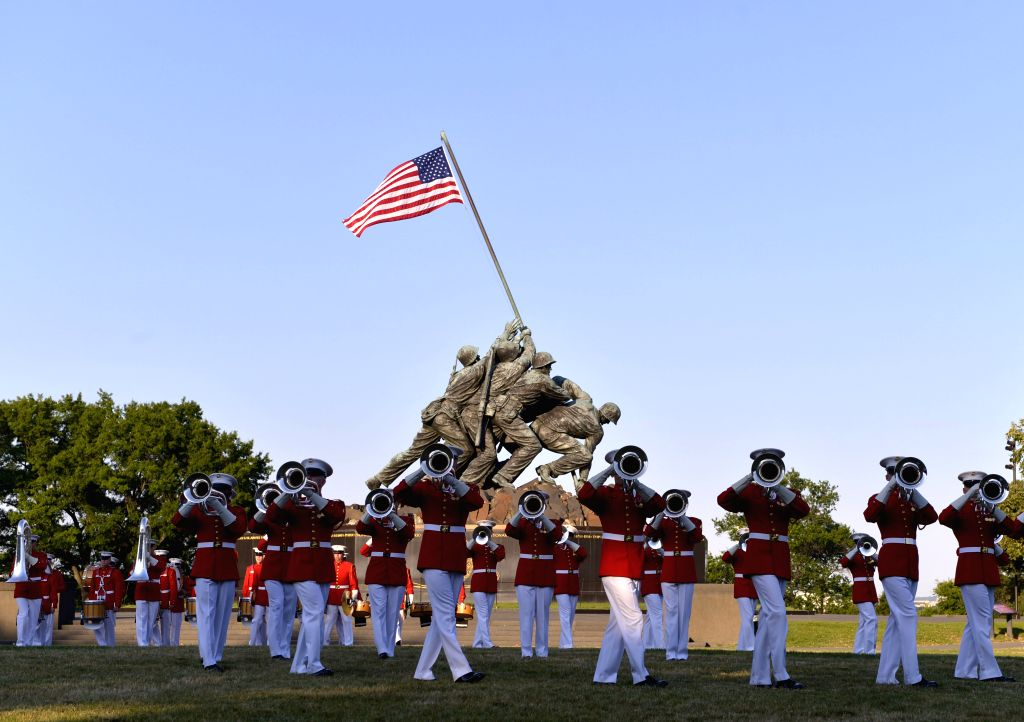 A band of the U.S. Marine Corps perform during the Marine Corps Sunset Parade at the Iwo Jima Memorial (formally known as the Marine Corps War Memorial) in .