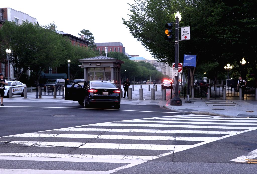 WASHINGTON D.C., June 3, 2019 (Xinhua) -- Snapshot taken from a video shows Secret Service agents outside the White House in Washington D.C., the United States, on June 2, 2019. A man was taken down near the White House on Sunday after U.S. Secret Se