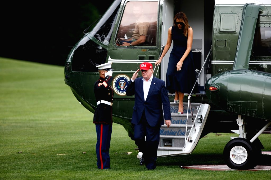 WASHINGTON D.C., June 8, 2019 - U.S. President Donald Trump and his wife Melania Trump arrive at the White House in Washington D.C. June 7, 2019. Donald Trump said on Friday that his country has ...