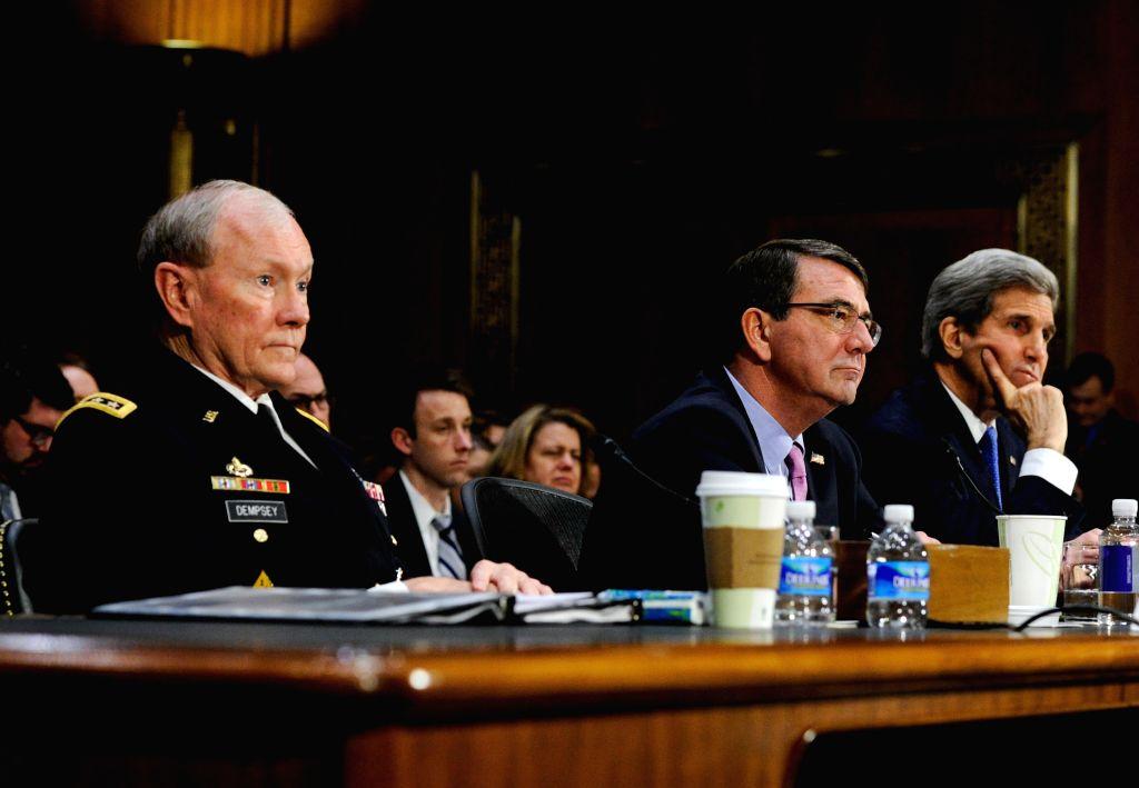 U.S. Secretary of State John Kerry (R), U.S. Defense Secretary Ashton Carter (C) and U.S. Chairman of the Joint Chiefs of Staff General Martin E. Dempsey ...