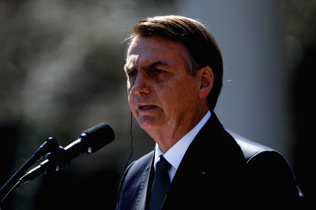 WASHINGTON D.C., March 20, 2019 (Xinhua) -- Brazil's President Jair Bolsonaro attends a joint press conference with U.S. President Donald Trump (not in the picture) at the Rose Garden of the White House in Washington D.C., the United States, on March