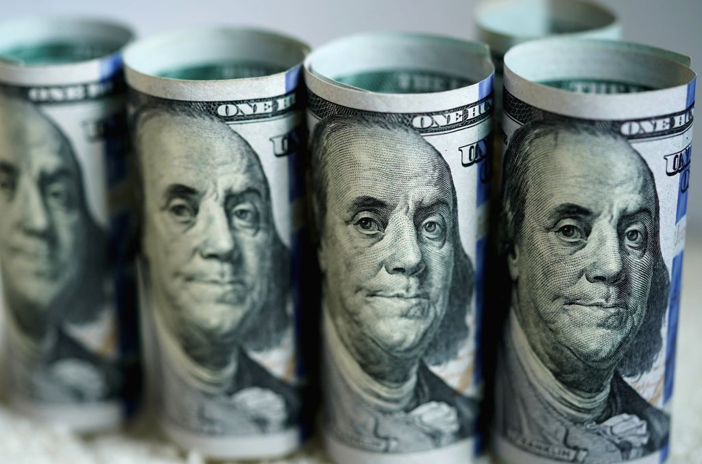 WASHINGTON D.C., March 20, 2020 Photo taken on March 19, 2020 shows U.S. dollar banknotes in Washington D.C., the United States. The Trump administration's plan to send Americans relief ...