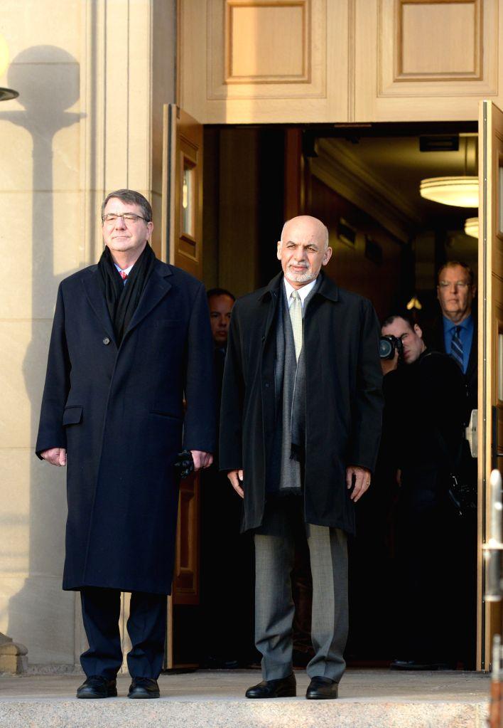 U.S. Defense Secretary Ashton Carter (L) hosts an honor cordon to welcome Afghan President Ashraf Ghani in the Pentagon, Washington D.C., the United ...