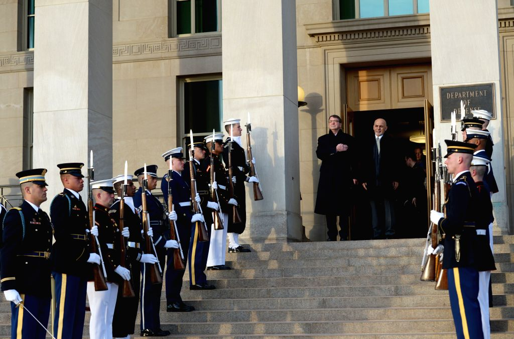 U.S. Defense Secretary Ashton Carter (center L) hosts an honor cordon to welcome Afghan President Ashraf Ghani in the Pentagon, Washington D.C., the ...