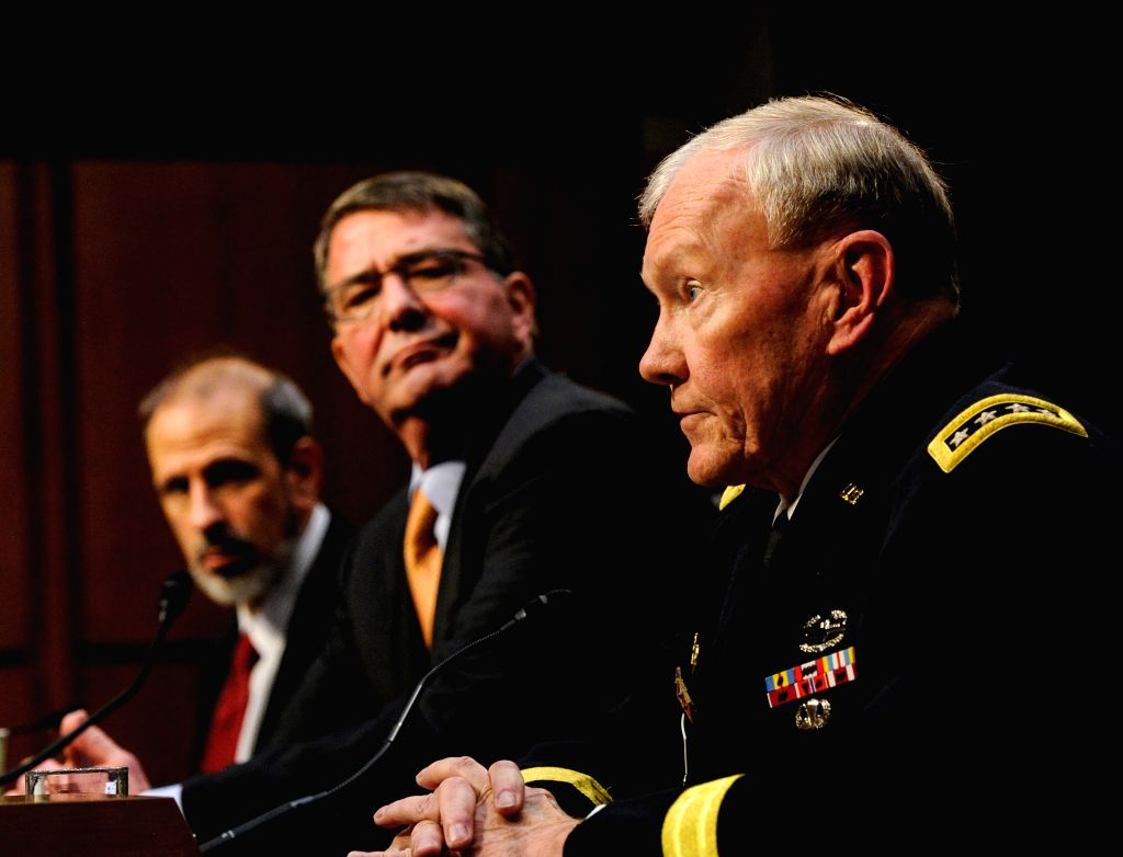 U.S. Chairman of the Joint Chiefs of Staff General Martin E. Dempsey (R) testifies before a Senate Armed Services Committee hearing on Defense Authorization ...