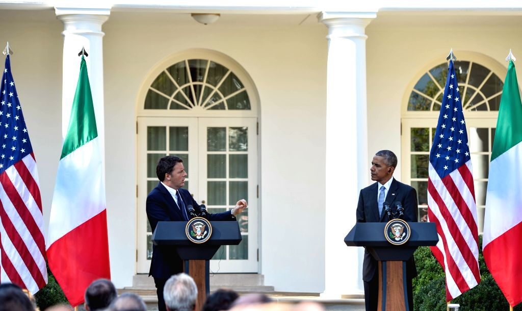 WASHINGTON D.C., Oct. 18, 2016 - Italian Prime Minister Matteo Renzi(L) speaks during a joint press conference with U.S. President Barack Obama at White House in Washington D.C., capital of the ... - Matteo Renzi