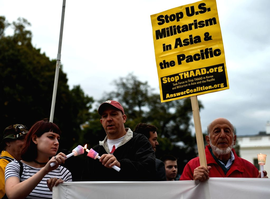 WASHINGTON D.C., Oct. 22, 2016 - People attend a rally outside the White House in Washington D.C., capital of the United States, Oct. 21, 2016. A rally against the deployment of Terminal High ...