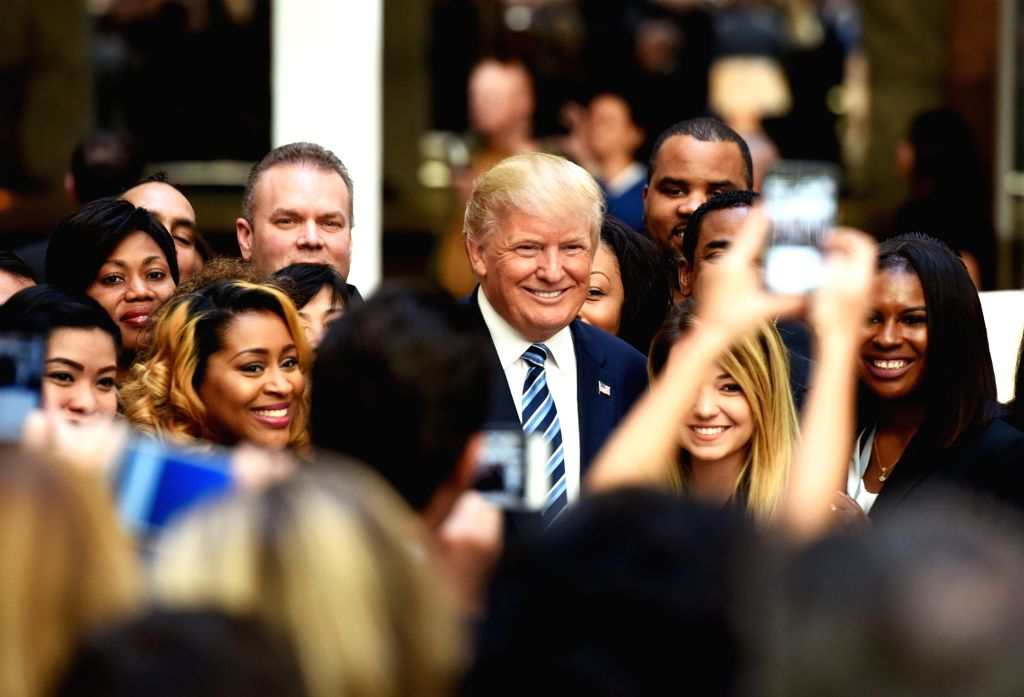 WASHINGTON D.C., Oct. 26, 2016 - U.S. Republican presidential nominee Donald Trump poses for photos during the opening and ribbon cutting ceremony of Trump International Hotel in Washington, D.C., ...