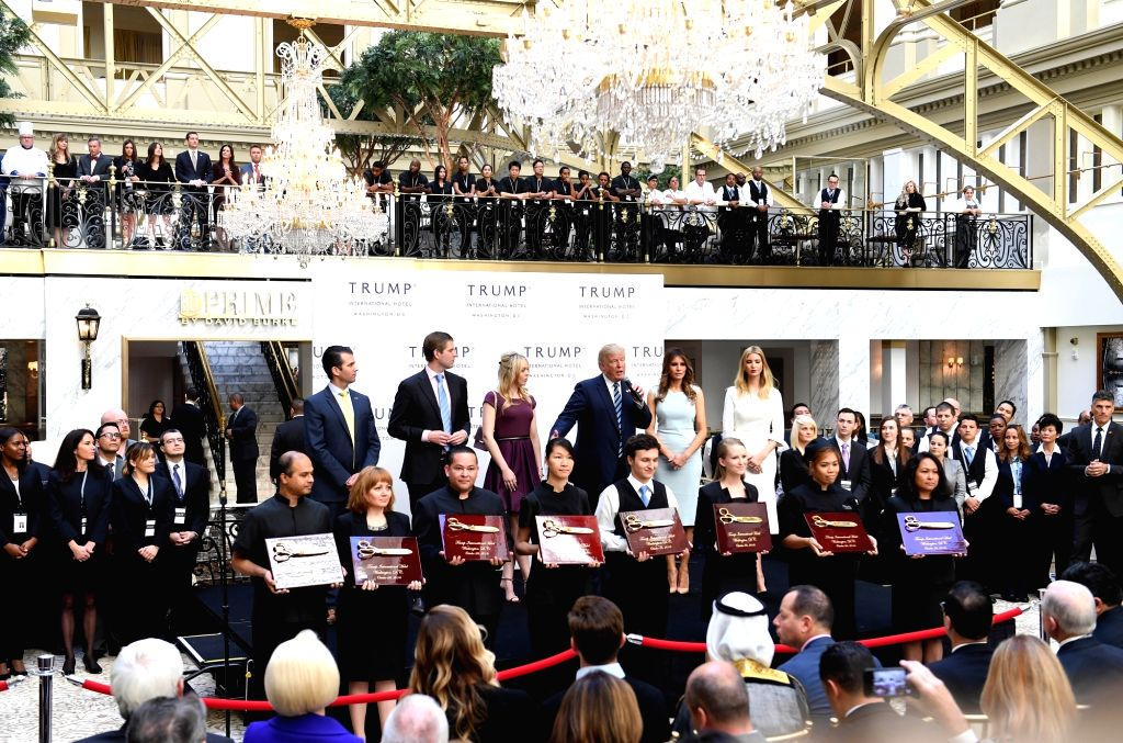 WASHINGTON D.C., Oct. 26, 2016 - U.S. Republican presidential nominee Donald Trump and his family members attend the opening and ribbon cutting ceremony of Trump International Hotel in Washington, ...