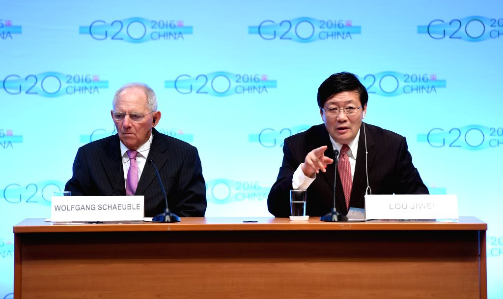 WASHINGTON D.C., Oct. 7, 2016 - Chinese Finance Minister Lou Jiwei(R) speaks at a press conference on G20 Finance Ministers and Central Bank Governors Meeting at the headquarters of International ... - Lou Jiwei