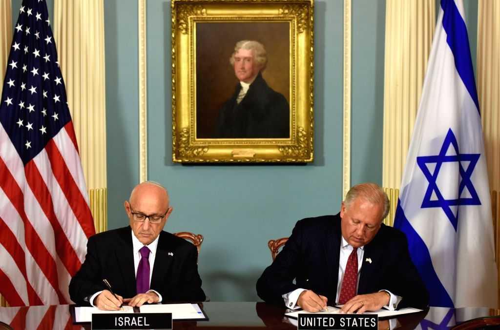 WASHINGTON D.C., Sept. 15, 2016 - U.S. Under Secretary of State Thomas Shannon (R) and Israel's acting national security advisor Jacob Nagel sign a military aid deal in Washington D.C. Sept. 14, ...