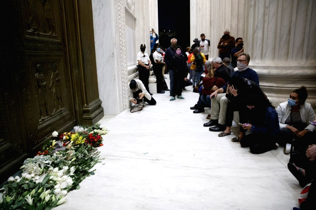 Washington, D.C., Sept. 19, 2020 People gather in front of the U.S. Supreme Court mourning the passing of U.S. Supreme Court Justice Ruth Bader Ginsburg in Washington, D.C., the United ...