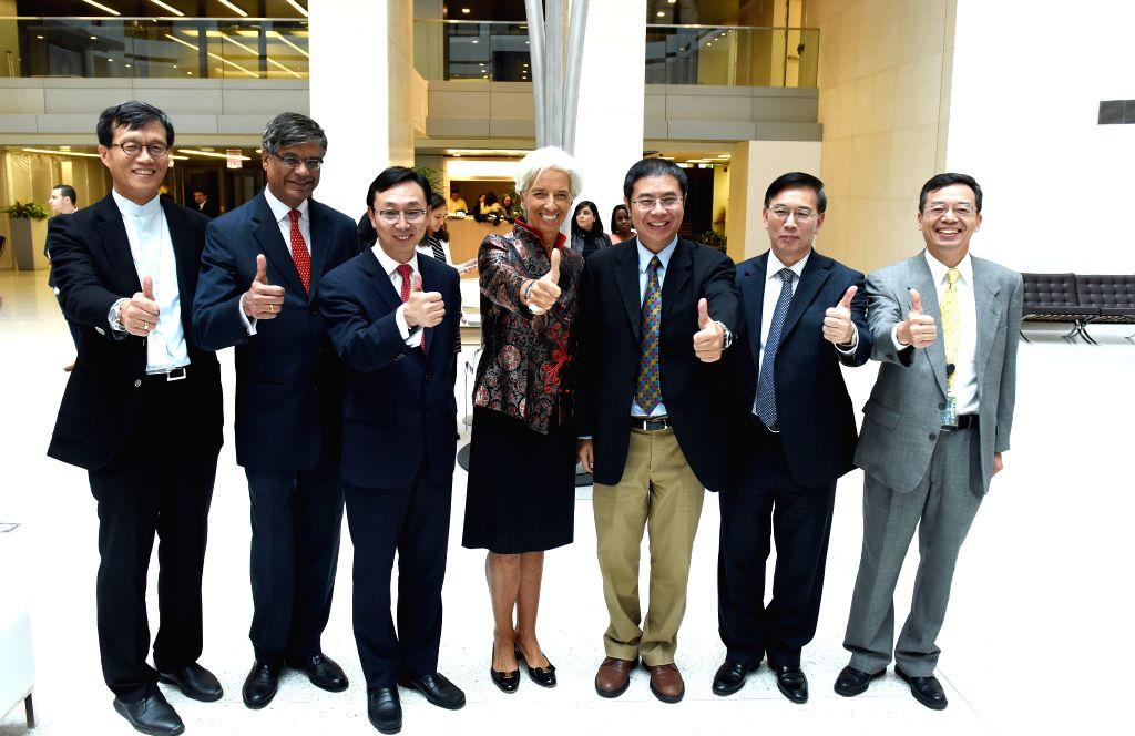WASHINGTON D.C., Sept. 30, 2016 - International Monetary Fund (IMF) Managing Director Christine Lagarde(C), IMF deputy managing director Zhang Tao(3rd L), IMF executive director for China Jin ... - Zhang Tao