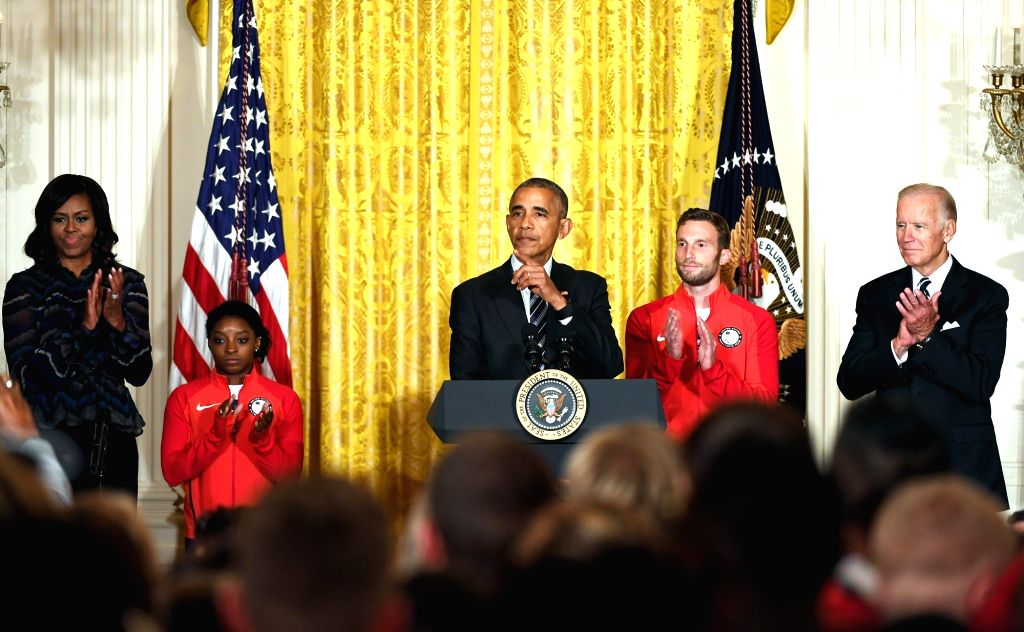 WASHINGTON D.C., Sept. 30, 2016 - U.S. President Barack Obama (C), First Lady Michelle Obama (1st, L), Vice President Joe Biden (1st, R), Olympic gymnast Simone Biles (2nd, L) and Paralympic athlete ...