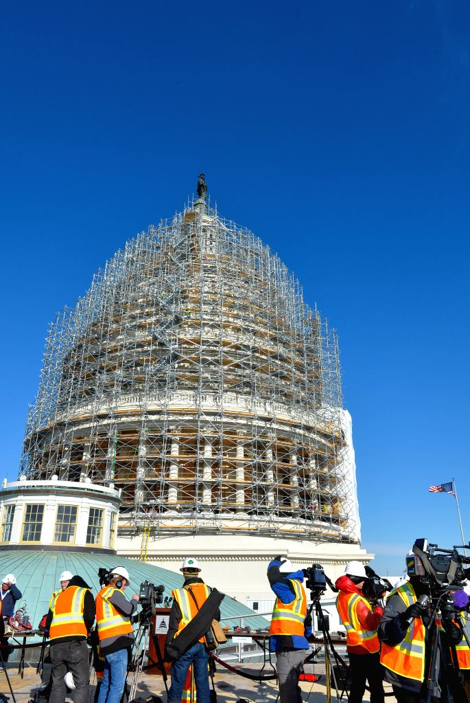 Washington D.C.(U.S.): U.S. Capitol Dome covered with scaffolding is seen during a restoration project in Washington D.C., capital of the United States, Nov. 18, 2014. A briefing for media on the ...