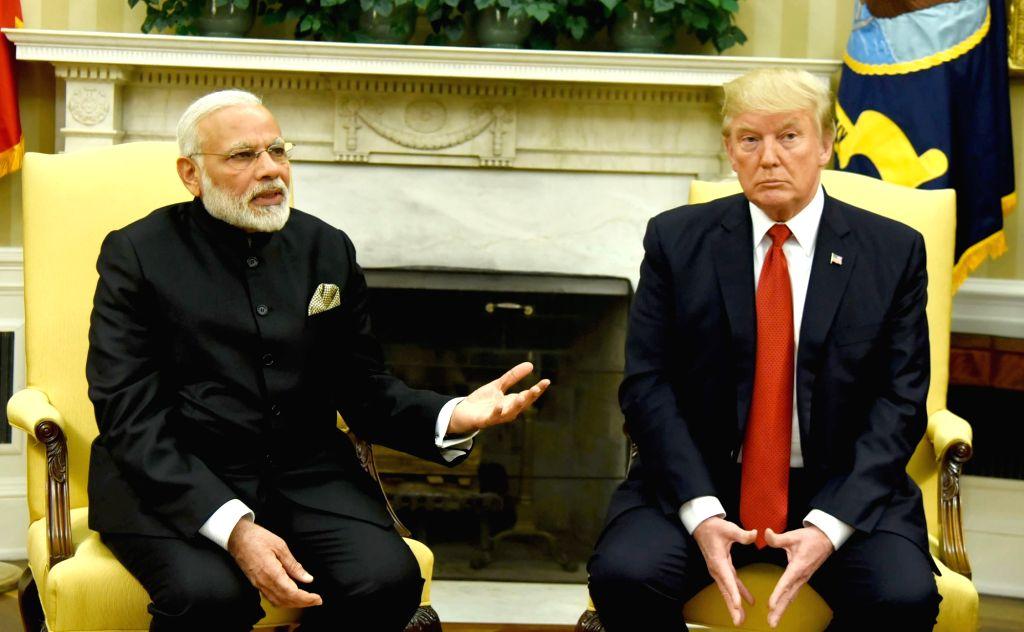 Washington DC: Prime Minister Narendra Modi meets President of United States of America (USA) Donald Trump, at White House, in Washington DC, USA on June 26, 2017. (Photo: IANS/PIB) - Narendra Modi