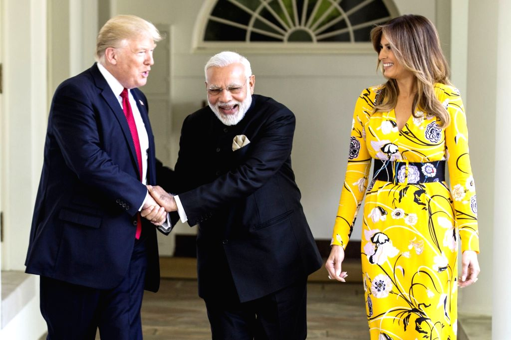 Washington DC: Prime Minister Narendra Modi with President of United States of America (USA) Donald Trump and the first lady of USA, Melania Trump, at White House, in Washington DC, USA on June 26, ... - Narendra Modi
