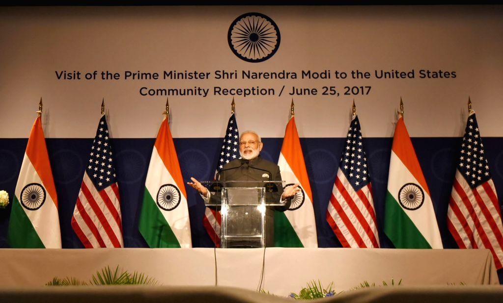 Washington DC: Prime MinisterNarendra Modi addresses at the Indian Community Reception, in Washington DC, USA on June 25, 2017. - Narendra Modi