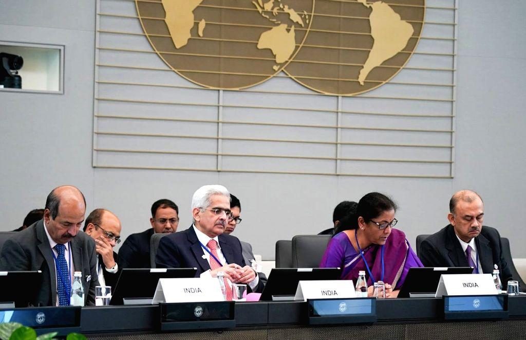 Washington DC: Union Finance and Corporate Affairs Minister Nirmala Sitharaman with Reserve Bank of India Governor Shaktikanta Das and Department of Economic Affairs Secretary Atanu Chakraborty, at ... - Nirmala Sitharaman