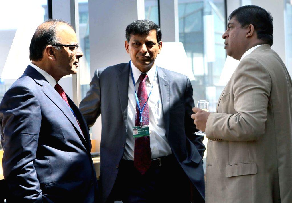Washington DC: Union Minister for Finance, Corporate Affairs and Information & Broadcasting Arun Jaitley, Reserve Bank of India Governor Raghuram Rajan and the Sri Lankan Finance Minister Ravi ... - Ravi Karunanayake and Arun Jaitley