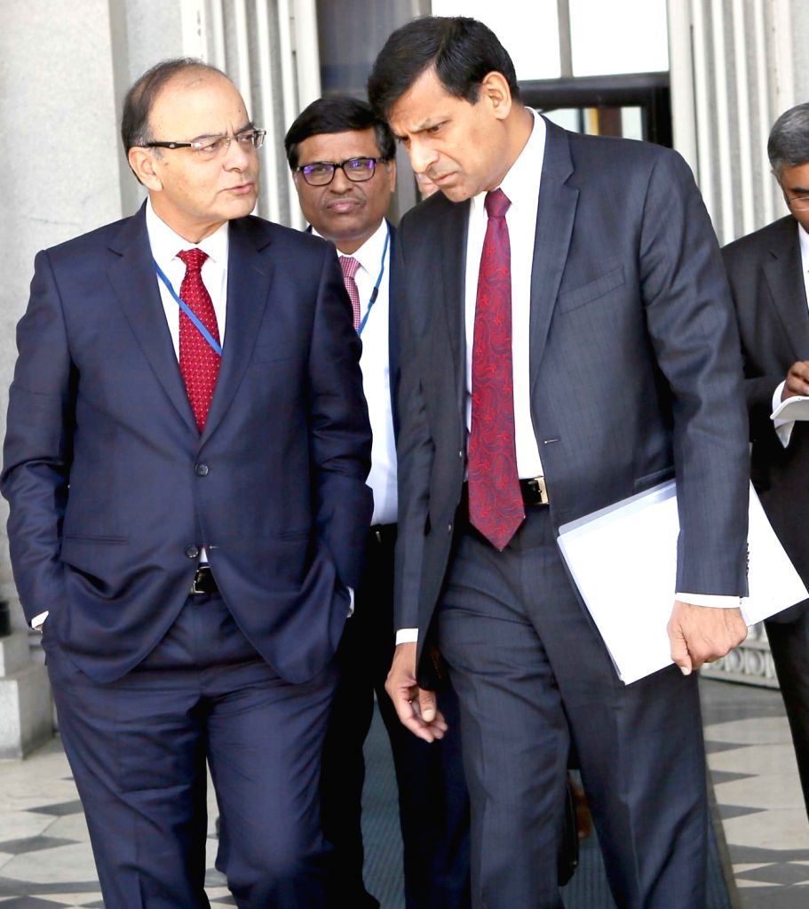Washington DC: Union Minister for Finance, Corporate Affairs and Information & Broadcasting Arun Jaitley and Reserve Bank of India Governor Raghuram Rajan, at the IMF 2016 Spring Summit, in ... - Arun Jaitley