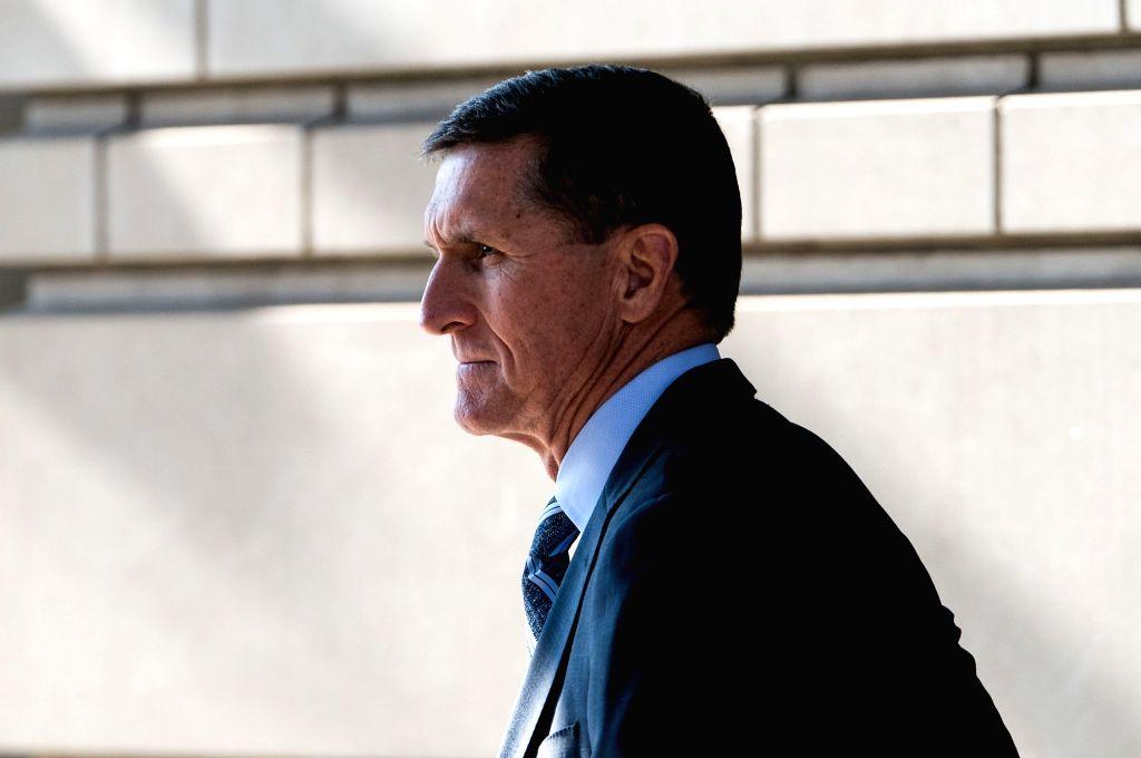 WASHINGTON, Dec. 1, 2017 (Xinhua) -- Former U.S. National Security Adviser Michael Flynn leaves the federal court following his plea hearing in Washington D.C., the United States, on Dec. 1, 2017. Former U.S. National Security Adviser Michael Flynn o