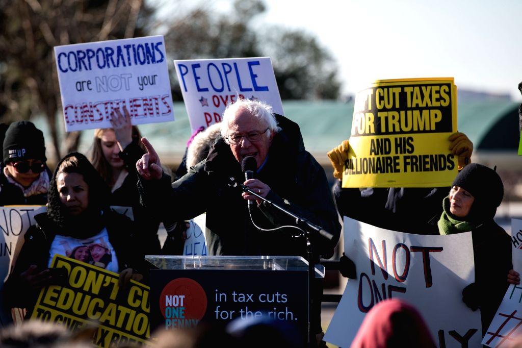 WASHINGTON, Dec. 13, 2017 (Xinhua) -- U.S. Senator Bernie Sanders (front) speaks during a rally against the Republican tax plan on Capitol Hill in Washington D.C., the United States, on Dec. 13, 2017. (Xinhua/Ting Shen/IANS)