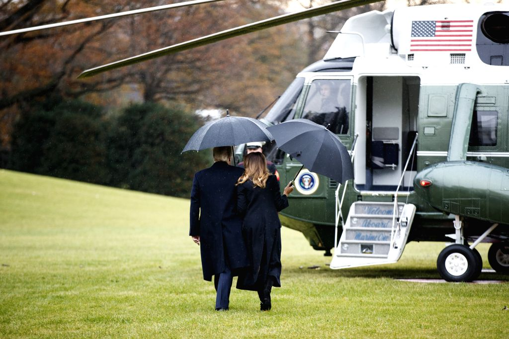 WASHINGTON, Dec. 2, 2019 (Xinhua) -- U.S. President Donald Trump and his wife Melania Trump depart from the White House in Washington D.C., the United States, on Dec. 2, 2019. U.S. President Donald Trump slammed an ongoing impeachment inquiry into hi