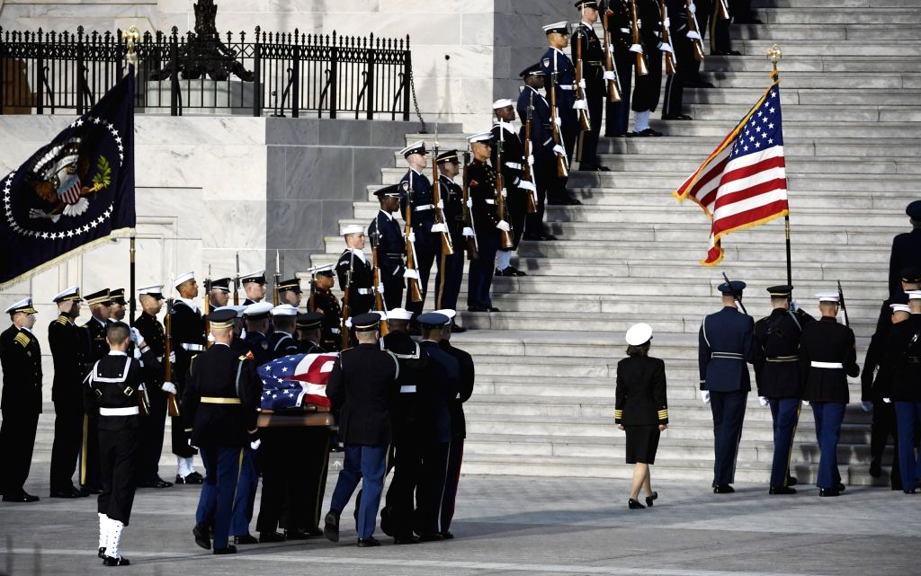 WASHINGTON, Dec. 3, 2018 - The casket of late former U.S. President George H.W. Bush is carried to the entrance of the U.S. Capitol, where it will lie in state, in Washington D.C., the United States, ...