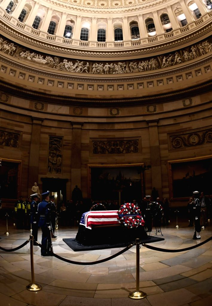 WASHINGTON, Dec. 4, 2018 - Photo taken on Dec. 4, 2018 shows the coffin of late former U.S. President George H.W. Bush lying in state in the U.S. Capitol Rotunda, in Washington D.C., the United ...