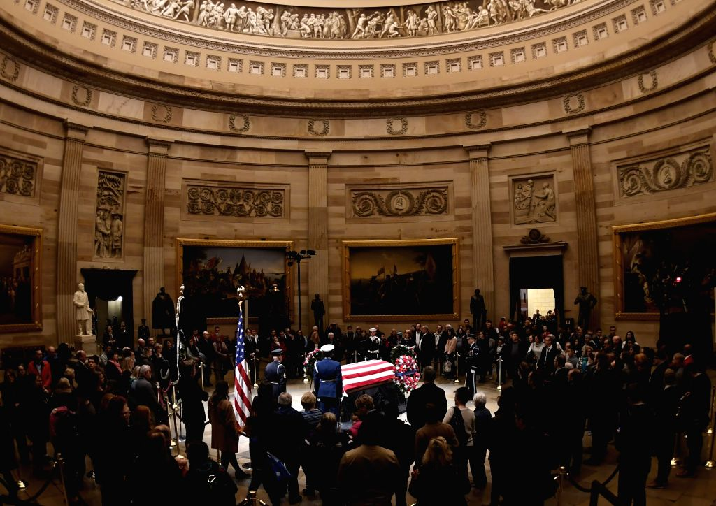 WASHINGTON, Dec. 4, 2018 - Visitors pay their respects to late former U.S. President George H.W. Bush lying in state in the U.S. Capitol Rotunda, in Washington D.C., the United States, on Dec. 3, ...
