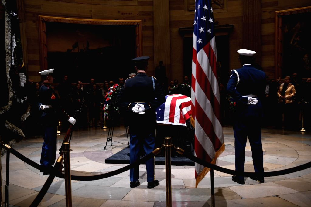 WASHINGTON, Dec. 4, 2018 - Visitors pay their respects to late former U.S. President George H.W. Bush lying in state in the U.S. Capitol Rotunda, in Washington D.C., the United States, on Dec. 4, ...
