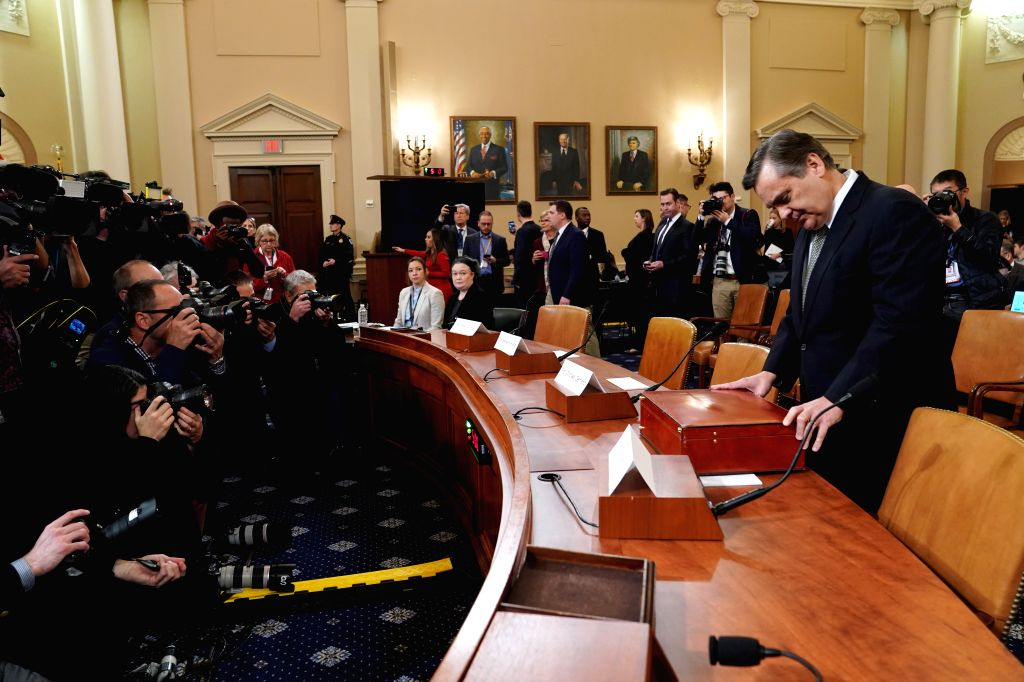 WASHINGTON, Dec. 4, 2019 - Jonathan Turley (1st R, front), professor of public interest law at the George Washington University Law School, waits to testify before the U.S. House Judiciary Committee ...