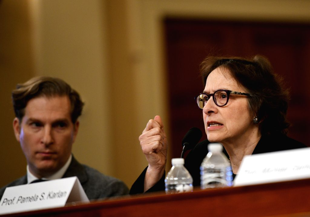 WASHINGTON, Dec. 4, 2019 - Noah Feldman (L), professor of law at Harvard Law School, and Stanford University Law Professor Pamela Karlan testify before the U.S. House Judiciary Committee on Capitol ...